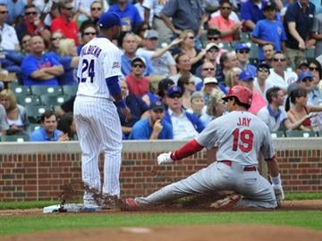 CHICAGO, IL - JULY 25: Jon Jay #19 of the St. Louis Cardinals slides safely into third base as Luis Valbuena #24 of the Chicago Cubs stands nearby on July 25, 2014 at Wrigley Field in Chicago, Illinois. (Photo by David Banks/Getty Images) By David Banks