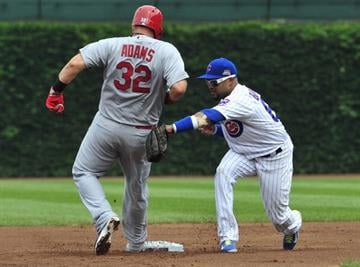 CHICAGO, IL - JULY 26: Matt Adams #32 of the St. Louis Cardinals is tagged out by Emilio Bonifacio #64 of the Chicago Cubs during the first inning on July 26, 2014 at Wrigley Field in Chicago, Illinois. (Photo by David Banks/Getty Images) By David Banks