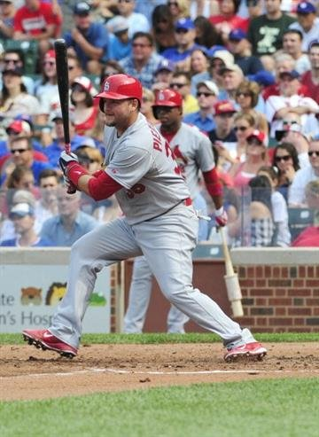 CHICAGO, IL - JULY 26: A.J. Pierzynski #35 of the St. Louis Cardinals  hits a single against the Chicago Cubs during the fourth inning on July 26, 2014 at Wrigley Field in Chicago, Illinois. (Photo by David Banks/Getty Images) By David Banks