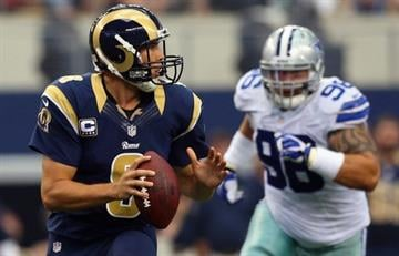 ARLINGTON, TX - SEPTEMBER 22:  Sam Bradford #8 of the St. Louis Rams throws against the Dallas Cowboys at AT&T Stadium on September 22, 2013 in Arlington, Texas.  (Photo by Ronald Martinez/Getty Images) By Ronald Martinez