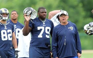 St. Louis Rams number one draft pick Greg Robinson stands with offensive line coach Paul Boudreau during the first day of organized team activities at Rams Park in Earth City, Missouri on June 5, 2014.    UPI/Bill Greenblatt By BILL GREENBLATT