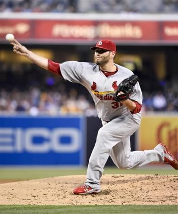 SAN DIEGO, CA - JULY 29:  Lance Lynn #31 of the St. Louis Cardinals pitches during the first inning of a baseball game against the San Diego Padres at Petco Park July 29, 2014 in San Diego, California.  (Photo by Denis Poroy/Getty Images) By Denis Poroy
