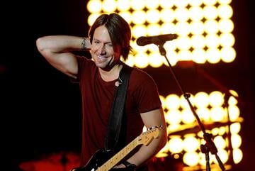 NASHVILLE, TN - JUNE 07:  Musician Keith Urban performs onstage during Day 1 of rehearsals for the 2011 CMT Music Awards at Bridgestone Arena on June 7, 2011 in Nashville, Tennessee.  (Photo by Rick Diamond/Getty Images for CMT) By Rick Diamond