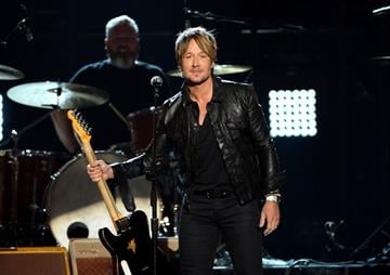 LAS VEGAS, NV - APRIL 06:  Singer/songwriter Keith Urban performs onstage during the 49th Annual Academy Of Country Music Awards at the MGM Grand Garden Arena on April 6, 2014 in Las Vegas, Nevada.  (Photo by Ethan Miller/Getty Images) By Ethan Miller