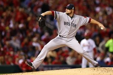 ST LOUIS, MO - OCTOBER 28:  Jon Lester #31 of the Boston Red Sox pitches against the St. Louis Cardinals during Game Five of the 2013 World Series at Busch Stadium on October 28, 2013 in St Louis, Missouri.  (Photo by Elsa/Getty Images) By Elsa