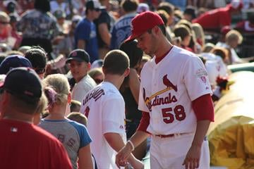 Joe Kelly of the St. Louis Cardinals signs autographs prior to a July 2012 game at Busch Stadium.  (Bryce Moore, KMOV.com) By Bryce Moore
