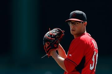 LAKE BUENA VISTA, FL - MARCH 15:  Joe Kelly #58 of the St. Louis Cardinals throws a pitch prior to a game against the Atlanta Braves at Champion Stadium on March 15, 2014 in Lake Buena Vista, Florida.  (Photo by Stacy Revere/Getty Images) By Stacy Revere