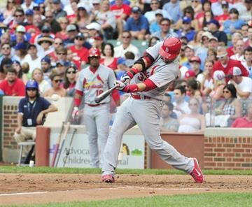 CHICAGO, IL - JULY 26: A.J. Pierzynski #35 of the St. Louis Cardinals  hits a single against the Chicago Cubs during the sixth inning on July 26, 2014 at Wrigley Field in Chicago, Illinois. (Photo by David Banks/Getty Images) By David Banks