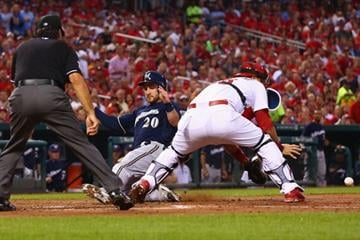 ST. LOUIS, MO - AUGUST 1: Jonathan Lucroy #20 of the Milwaukee Brewers scores a run against the St. Louis Cardinals in the third inning at Busch Stadium on August 1, 2014 in St. Louis, Missouri.  (Photo by Dilip Vishwanat/Getty Images) By Dilip Vishwanat