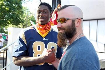 St. Louis Cardinals pitcher Jason Motte and St. Louis Rams tight end Jared Cook say hello as the two greet people participating in the annual Koman Race for the Cure in St. Louis on June 14, 2014. UPI/Bill Greenblatt By BILL GREENBLATT