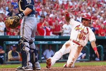 ST. LOUIS, MO - AUGUST 2: Kolten Wong #16 of the St. Louis Cardinals scores a run in the second inning against the Milwaukee Brewers at Busch Stadium on August 2, 2014 in St. Louis, Missouri.  (Photo by Dilip Vishwanat/Getty Images) By Dilip Vishwanat