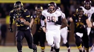 Missouri running back Henry Josey, left, scores on a 57-yard touchdown run during the fourth quarter of an NCAA college football game against Texas A&M on Saturday, Nov. 30, 2013, in Columbia, Mo. (AP Photo/Jeff Roberson) By Jeff Roberson