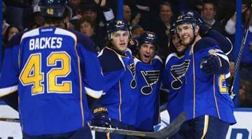 Blues captain David Backes (left), was one of several players to visit area hospitals Friday By Elizabeth Eisele