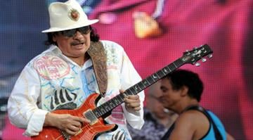 US guitarist and singer Carlos Santana performs on July 21, 2013 during the Vieilles Charrues music Festival in Carhaix-Plouguer, western of France. AFP PHOTO FRED TANNEAU (Photo credit should read FRED TANNEAU/AFP/Getty Images) By Alexander Schuster