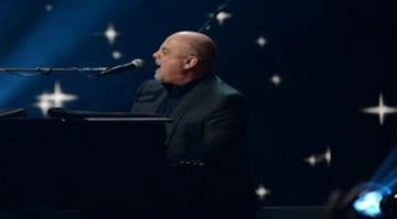 Billy Joel performs during '12-12-12 The Concert For Sandy Relief' December 12, 2012 at Madison Square Garden in New York. AFP PHOTO/DON EMMERT (Photo credit should read DON EMMERT/AFP/Getty Images) By Alexander Schuster