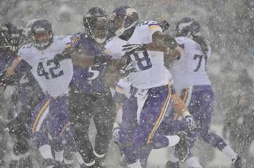 BALTIMORE, MD - DECEMBER 08: Running back Adrian Peterson #28 of the Minnesota Vikings runs the ball against the Baltimore Ravens at M&T Bank Stadium on December 8, 2013 in Baltimore, Maryland. (Photo by Larry French/Getty Images) By Larry French