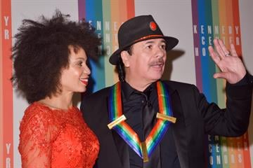 WASHINGTON, DC - DECEMBER 8: Cindy Blackman and Carlos Santana pose on the red carpet during the The 36th Kennedy Center Honors gala at the Kennedy Center on December 8, 2013 in Washington, DC.   (Photo by Kris Connor/Getty Images) By Kris Connor