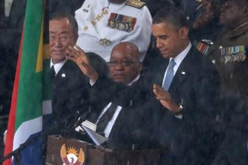 World leaders remember Mandela.  Obama's eulogy is the day's rhetorical highlight, with the crowd at the Johannesburg soccer stadium erupting in thunderous applause. By Chip Somodevilla