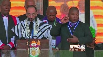 Experts call out interpreter at Mandela service.  Advocates for the deaf say the man, who stood on stage just a yard from Obama and other world leaders appearing to do sign language, was a fake. By Carlos Otero