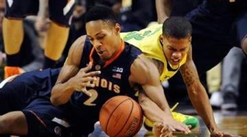 Illinois guard Joseph Bertrand (2) and Oregon guard Joseph Young (3) scramble for a loose ball during the first half of an NCAA college basketball game in Portland, Or., Saturday, Dec. 14, 2013. (AP Photo/Steve Dykes) By Steve Dykes