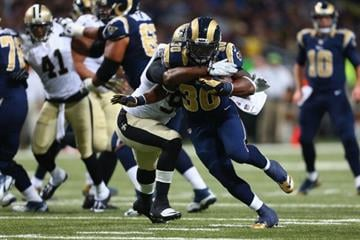 ST. LOUIS, MO - DECEMBER 15: Zac Stacy #30 of the St. Louis Rams rushes against the New Orleans Saints at the Edward Jones Dome on December 15, 2013 in St. Louis, Missouri.  (Photo by Dilip Vishwanat/Getty Images) By Dilip Vishwanat