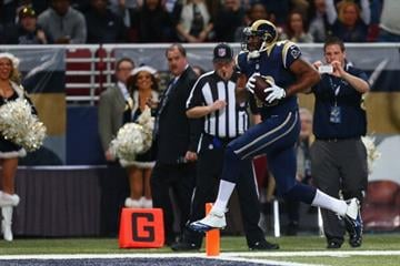 ST. LOUIS, MO - DECEMBER 15: Cory Harkey #46 of the St. Louis Rams scores a touchdown against the New Orleans Saints at the Edward Jones Dome on December 15, 2013 in St. Louis, Missouri.  (Photo by Dilip Vishwanat/Getty Images) By Dilip Vishwanat