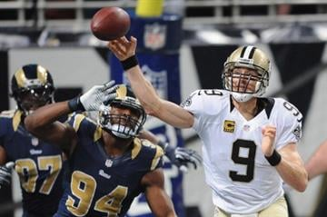 ST. LOUIS, MO - DECEMBER 15: Drew Brees #9 of the New Orleans Saints passes against the St. Louis Rams in the third quarter at the Edward Jones Dome on December 15, 2013 in St. Louis, Missouri.  (Photo by Michael Thomas/Getty Images) By Michael Thomas