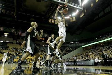 COLUMBIA, MO - DECEMBER 15:  Ryan Rosburg #44 of the Missouri Tigers dunks during the game against the Western Michigan Broncos at Mizzou Arena on December 15, 2013 in Columbia, Missouri.  (Photo by Jamie Squire/Getty Images) By Jamie Squire
