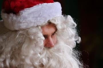 MELBOURNE, AUSTRALIA - DECEMBER 16:  Santa Claus poses during a photo shoot at the Santas Place shop on December 16, 2013 in Melbourne, Australia.  (Photo by Michael Dodge/Getty Images) By Michael Dodge