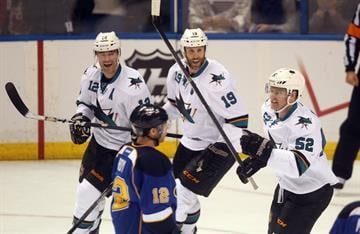 San Jose Sharks Patrick Marleau (12) and Joe Thornton (19) skate in to celebrate a goal by Matt Irwin (52) against the St. Louis Blues in the first period at the Scottrade Center in St. Louis on December 17, 2013. UPI/Bill Greenblatt By BILL GREENBLATT