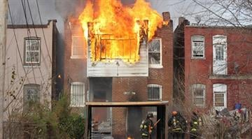 St. Louis firefighters retreat from the flames in a vacant building in north St. Louis on December 19, 2013. Firefighters eventually got the blaze under control without injuries.   UPI/Bill Greenblatt By BILL GREENBLATT