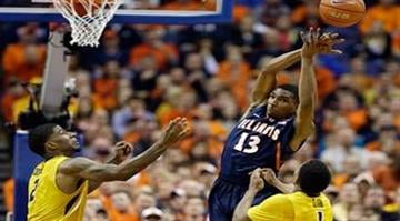 Illinois' Tracy Abrams (13) reaches for a rebound as Missouri's Tony Criswell, left, and Wes Clark watch during the first half of an NCAA college basketball game on Saturday, Dec. 21, 2013, in St. Louis. (AP Photo/Jeff Roberson) By Jeff Roberson