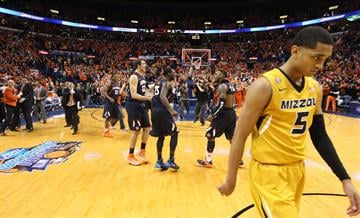 Missouri Tigers Jordan Clarkson walks off the court as the Illinois Illini begin to celebrate their 65-64 win in the Annual Braggin' Rights Game at the Scottrade Center in St. Louis on December 21, 2103.   UPI/Bill Greenblatt By BILL GREENBLATT