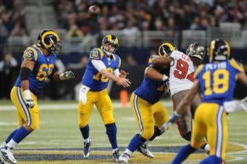 ST. LOUIS, MO - DECEMBER 22: Kellen Clemens #10 of the St. Louis Rams passes against the Tampa Bay Buccaneers at the Edward Jones Dome on December 22, 2013 in St. Louis, Missouri.  (Photo by Michael Thomas/Getty Images) By Michael Thomas