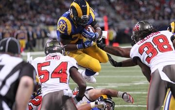 St. Louis Rams Zac Stacy dives over the Tampa Bay Buccaneers defense for a touchdown in the second quarter at the Edward Jones Dome in St. Louis on December 22, 2013.   UPI/Bill Greenblatt By BILL GREENBLATT