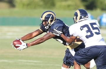 St. Louis Rams Raymond Radway (L) reaches for goal line in front of Darren Woodard during training camp at the team practice facility in Earth City , Missouri on August 1, 2013.   UPI/Bill Greenblatt By BILL GREENBLATT