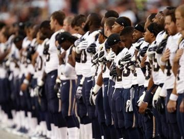 CLEVELAND, OH - AUGUST 08:  St. Louis Rams' players stand for the national anthem before their game against the Cleveland Browns at FirstEnergy Stadium on August 8, 2013 in Cleveland, Ohio.  (Photo by Matt Sullivan/Getty Images) By Matt Sullivan