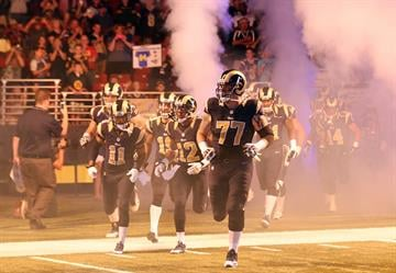 The St. Louis Rams run onto the field for a pre season game against the Green Bay Packers at the Edward Jones Dome in St. Louis on August 17, 2013.   UPI/Bill Greenblatt By BILL GREENBLATT