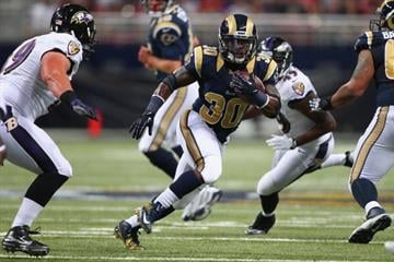 ST. LOUIS, MO - AUGUST 29: Zac Stacy #30 of the St. Louis Rams rushes against the Baltimore Ravens during a pre-season game at the Edward Jones Dome on August 29, 2013 in St. Louis, Missouri.  (Photo by Dilip Vishwanat/Getty Images) By Dilip Vishwanat