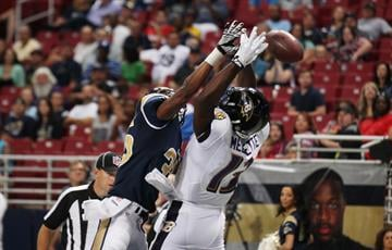 St. Louis Rams Darren Woodward knocks the football free from the hands of Baltimore Ravens Aaron Mellette in the second quarter at the Edward Jones Dome in St. Louis on August 29, 2013.   UPI/Bill Greenblatt By BILL GREENBLATT