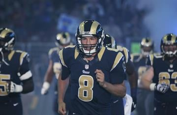 St. Louis Rams quarterback Sam Bradfrod runs onto the field for a pre-season game against the Green Bay Packers at the Edward Jones Dome in St. Louis on August 17, 2013.   UPI/Bill Greenblatt By BILL GREENBLATT