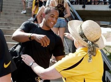 Missouri quarterback James Franklin, left, hugs a fan as the team enters the stadium prior to the start of the Murray State-Missouri NCAA college football game Saturday, Aug. 31, 2013, in Columbia, Mo. (AP Photo/L.G. Patterson) By L.G. Patterson