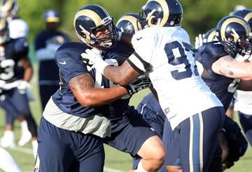 St. Louis Rams Roger Staffold (76) fights off Eugene Sims (97) during training camp at the team practice facility in Earth City , Missouri on August 1, 2013.   UPI/Bill Greenblatt By BILL GREENBLATT