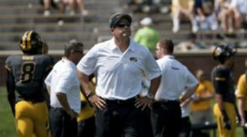Missouri head coach Gary Pinkel looks up at the crowd during warmups before the start of an NCAA college football game between Toledo and Missouri Saturday, Sept. 7, 2013, in Columbia, Mo. By L.G. Patterson