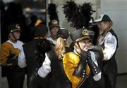Members of Marching Mizzou put their uniforms on before the start of an NCAA college football game between Toledo and Missouri Saturday, Sept. 7, 2013, in Columbia, Mo. (AP Photo/L.G. Patterson) By L.G. Patterson