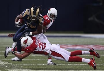 St. Louis Rams Daryl Richardson is tackeled by Arizona Cardinals Rashad Johnson in the first quarter at the Edward Jones Dome in St. Louis on September 8, 2013. St. Louis won the game 27-24.    UPI/Bill Greenblatt By BILL GREENBLATT