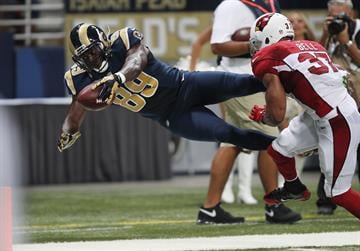 St. Louis Rams Jared Cook dives for the endzone and a touchdown in front of Arizona Cardinals Yeremiah Bell in the second quarter at the Edward Jones Dome in St. Louis on September 8, 2013.   UPI/Bill Greenblatt By BILL GREENBLATT