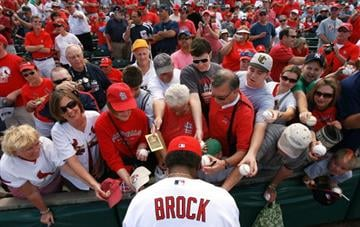 JUPITER, FL - MARCH 10:  Hall-of-Famer Lou Brock #20 of the St Louis Cardinals signs autographs for fans before taking on the Washington Nationals at Roger Dean Stadium on March 10, 2010 in Jupiter, Florida.  (Photo by Doug Benc/Getty Images) By Doug Benc