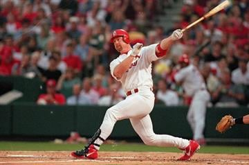 10 Jul 1997: Mark McGwire #25 of the St. Louis Cardinals hits the ball during the game against the Houston Astros at the Busch Stadium in St. Louis, Missouri. The Cardinals defeated the Astros 6-3. Mandatory Credit: Stephen Dunn  /Allsport By Stephen Dunn