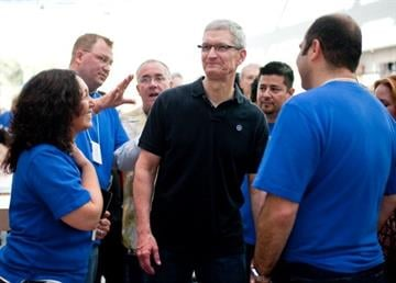 PALO ALTO - OCTOBER 27 : In this handout image provided by Apple, Apple store employees greet CEO Tim Cook at the new Apple Store on October 27, 2012 in Palo Alto, California. (Photo by Don Feria/Apple via Getty Images) By Handout